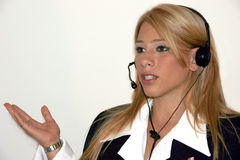 Sure! Ican help You. Executive, business woman with headset Stock Photo