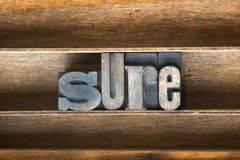 Sure wooden tray. Sure word made from vintage letterpress type on wooden tray Stock Images
