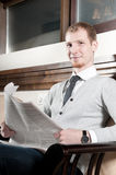 Sure young business man with newspaper Royalty Free Stock Photos