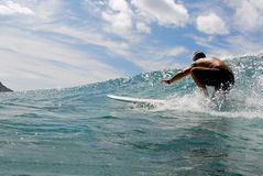 Surf. A surfer surfing in beautiful Hawaii Stock Photos
