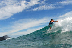 Surf. A surfer surfing in beautiful Hawaii Stock Images