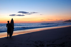 Surf On !!. Man watches for waves on the Pacific ocean Stock Image