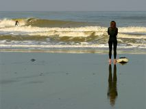 Surf. Gril waiting for big wave on nordsea Stock Images