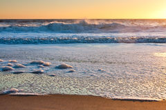 Surf Approaching Beach at Sunrise Stock Photography