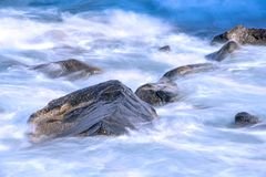 Surf of the atlantic ocean in long time exposure. Surf of the atlantic ocean in Tenerife in long time exposure Stock Photo