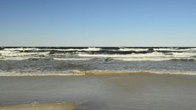 Surf of the Baltic Sea in Poland. With blue sky stock footage