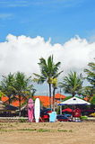 Surf beach with deck chairs on the sandy shore of the island of Bali Stock Photo