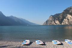 Surf beaches Lago di Garda. In Italy,waiting for wind on the pebble beach Stock Image