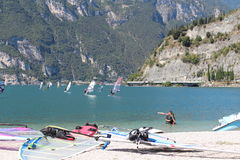 Surf beaches Lago di Garda. In Italy,waiting for wind on the pebble beach Royalty Free Stock Image