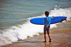 A surf beginner Royalty Free Stock Image