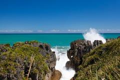 Surf in blowhole Pancake Rocks of Punakaiki, NZ Royalty Free Stock Photo