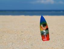 Surf board on bali beach. Colorful surf board souvenir on the beach in Bali Island Stock Image