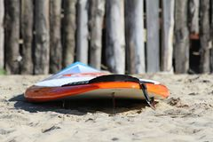 Surf board on the beach. The colourful surf board on wood background royalty free stock photography
