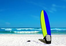 Surf Board on the Beach. With Sea Wave and Blue Sky Stock Images