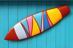 Surf board Mock up. The colourful surf board on sky blue wood background Stock Images