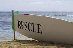 Surf Board Safety Concept on Hawaiian Sandy Beach Stock Images