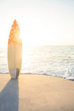 surf board standing on the sand stock image