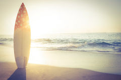 Surf board standing on the sand Stock Photography