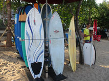 Surf board. Traders rent a surf board on a beach in Bali, Indonesia Royalty Free Stock Images
