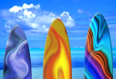 Surf Boards. Against tropical ocean background Royalty Free Stock Images