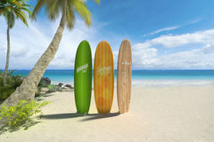 Surf boards on the beach. 3D rendering of three colorful surf boards on a tropical beach Stock Images