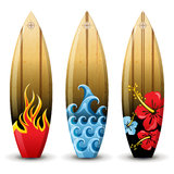 Surf boards. 3 colorful woored surf boards Royalty Free Stock Photo