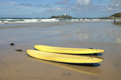 Surf boards on Gwithian Towans. With Godrevy Lighthouse in the background, Cornwall, UK Royalty Free Stock Photo