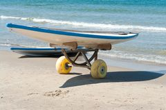 Surf boards on a  sandy beach Stock Image