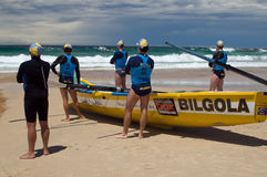 Surf Boat Carnival. Clubbies from the Bilgola boat watch from the beach at the Mollymook Surf Boat Classic, Australia royalty free stock photos