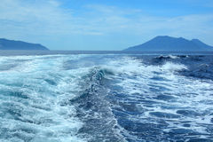 Surf from boat. Sea surf and waves from motor boat sailing the sea Royalty Free Stock Images