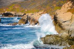 Surf breaking on cliffs along the beautiful Big Sur coast in California stock photos