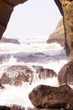 Surf breaking on entrance to Devil's Punch Bowl Royalty Free Stock Images