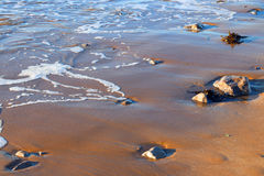 Surf breaking onto a beach. Royalty Free Stock Photography