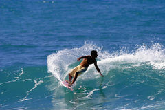 Surf Carving Surfer. A young man surfing in Hawaii Royalty Free Stock Image