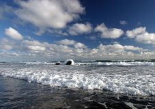 Surf & Clouds. Coastal image taken from a beach on New Zealand's 'Surf Highway royalty free stock photos