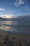 Surf fishing. Fishing a secluded surf beach Stock Photo