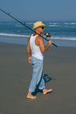 Surf Fishing. Male in hat Surf Fishing along the New Jersey Beach Royalty Free Stock Photo