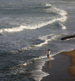 Surf Fishing. Man spending morning fishing along Northern California's coast Royalty Free Stock Photo