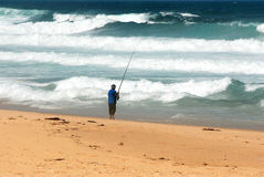 Surf Fishing. Man fishing at surf beach Stock Photos