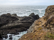 Surf fishing. Ocean fishing from a rocky point high above the water Stock Photo