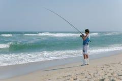 Surf fishing off Sandy Hook beach stock photography