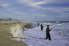 Surf fishing on Sea Girt beach on the Jersey Shore Royalty Free Stock Images