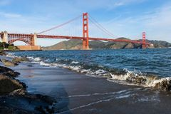 Surf in front of Golden Gate Bridge worldwide known symbol of California. Morning surf in front of Golden Gate Bridge worldwide known symbol of California royalty free stock photo