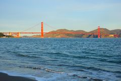 Surf in front of Golden Gate Bridge worldwide known symbol of California. Morning surf in front of Golden Gate Bridge worldwide known symbol of California royalty free stock photography