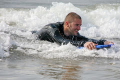 Surf Fun. Young man boogie boarding in surf in cornwall, england Stock Images