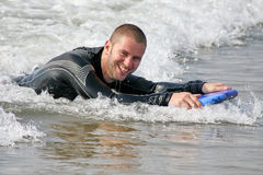 Surf Fun. Young man boogie boarding in surf in cornwall, england Stock Image