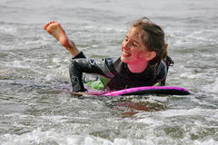 Surf Fun. Young girl boogie boarding in surf in cornwall, england Stock Photos