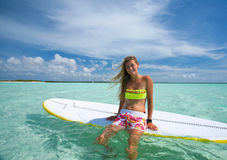 Surf girl. Beautiful surf girl on SUP (stand up paddle) board, Dutch Antilles, Caribbean islands stock photo