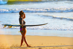 Surf girl on the beach Royalty Free Stock Image