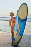 Surf girl looking out at blue ocean Stock Photography